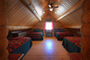 Loft bedroom of log cabin on the Big Hole River